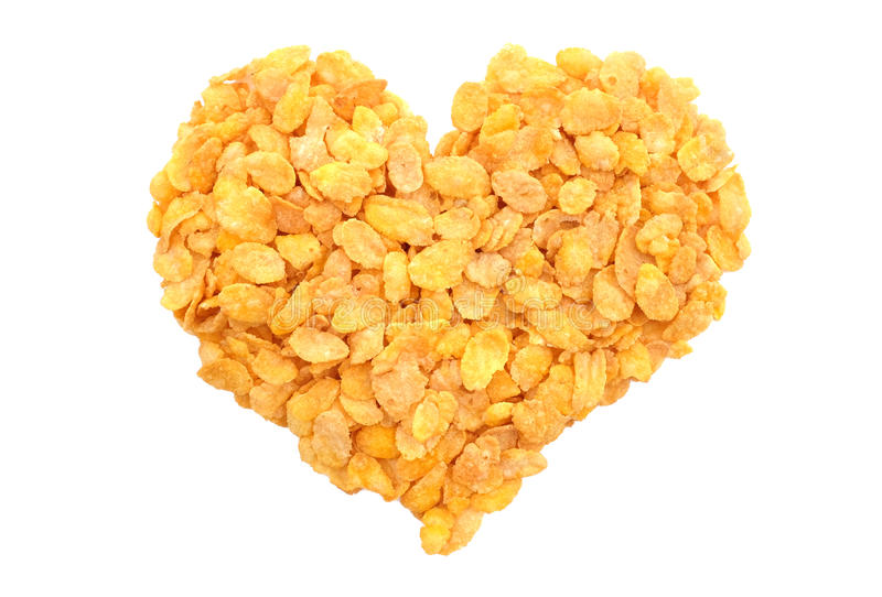 Corn flakes breakfast cereal heart. Corn flakes breakfast cereal in a heart shape, isolated on a white background royalty free stock image