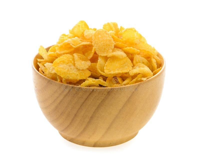 Corn Flakes in der hölzernen Schüssel auf weißem Hintergrund lizenzfreies stockbild
