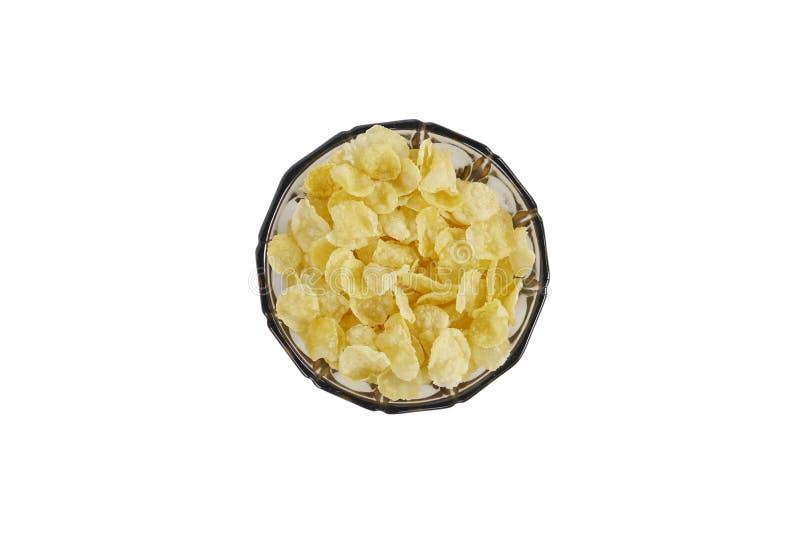 Corn-Flakes in einer bräunlichen traditionellen Glasschüssel mit Stand Geschossen von oben lizenzfreie stockfotografie