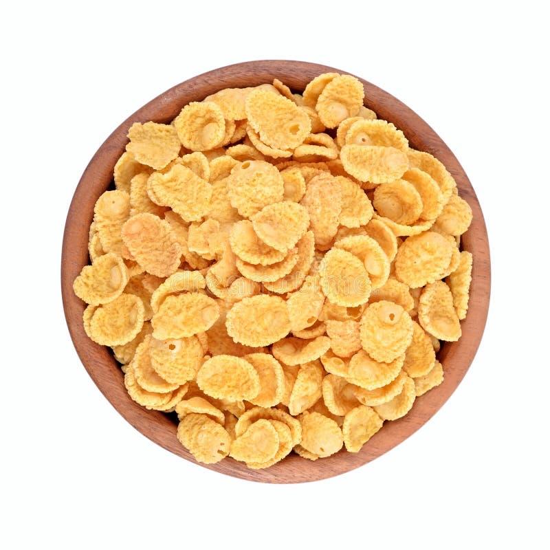 Corn-Flakes in einer hölzernen Schüssel auf einem weißen Hintergrund stockbilder