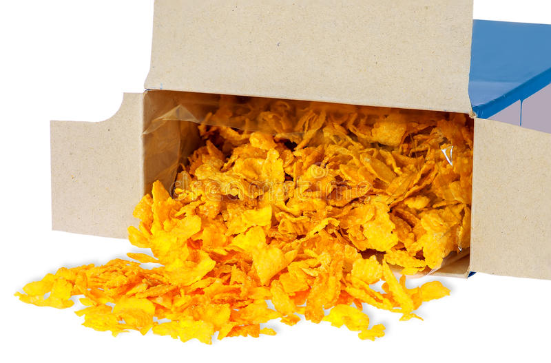 Corn flakes spill out of cardboard box royalty free stock image