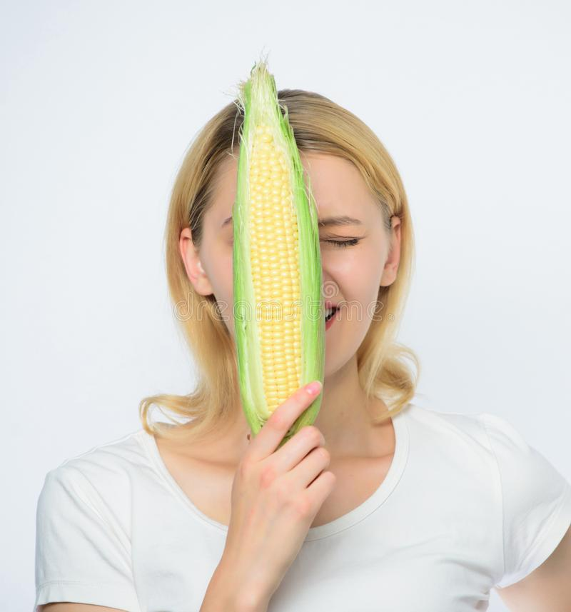 Corn harvest. Girl hold ripe corn. Food vegetarian and healthy natural organic products. Vegetarian menu. Eat corn royalty free stock image
