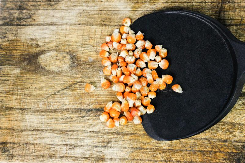 Corn kernel on cutting board royalty free stock image