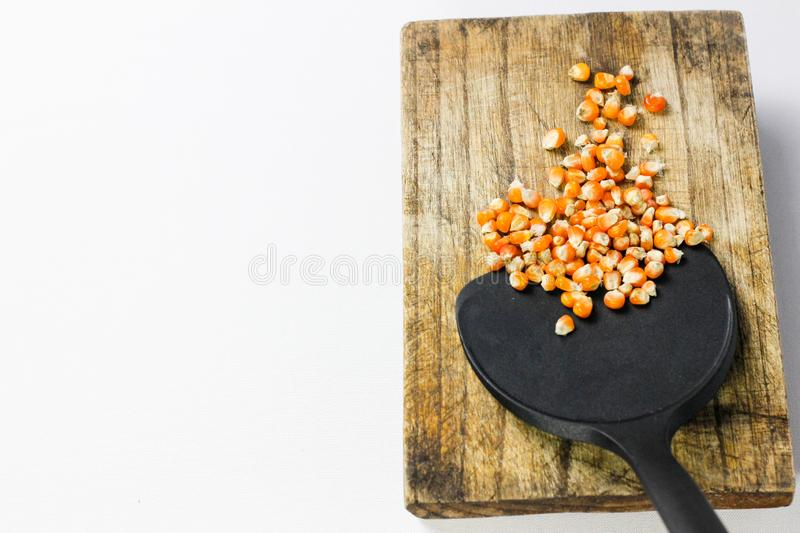 Corn kernel on cutting board royalty free stock images