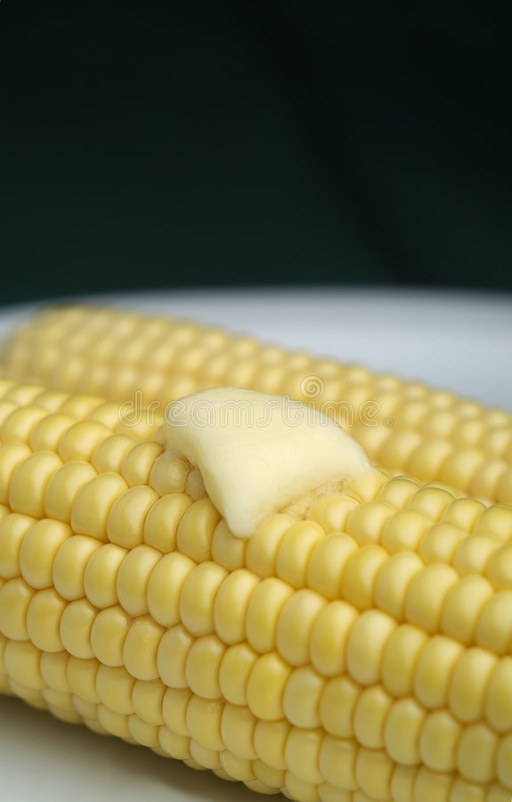Corn with melted butter stock image