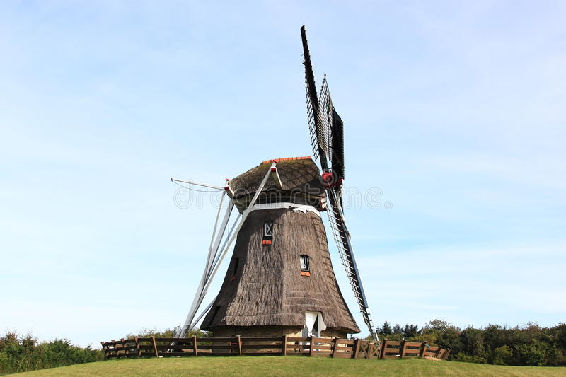 Corn mill De Phenix of Nes at Ameland, Holland. Corn mill 'De Phenix' is an old grain and peel mill that still works perfectly, thanks to a thorough renovation stock image