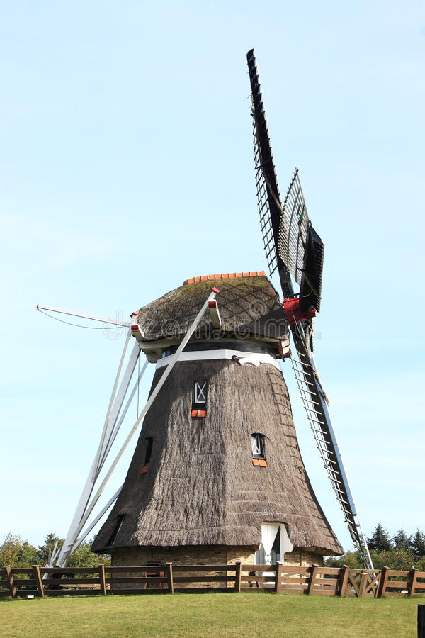 Corn mill De Phenix in Nes, Ameland Island, Holland. Corn mill 'De Phenix' is an old grain and peel mill that still works perfectly, thanks to a thorough royalty free stock image