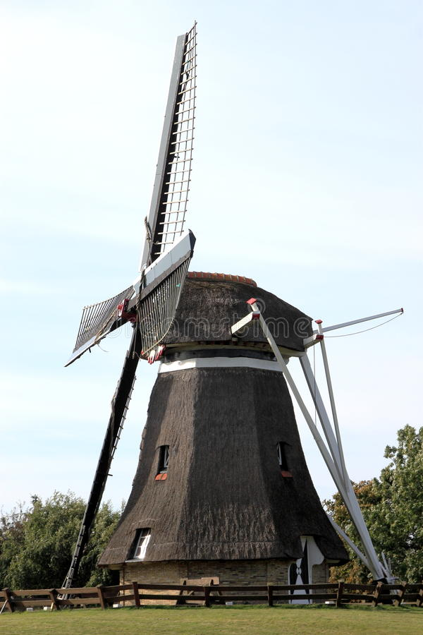Corn mill De Phenix of Nes at Ameland Island, Holland. Corn mill 'De Phenix' is an old grain and peel mill that still works perfectly, thanks to a thorough royalty free stock photo
