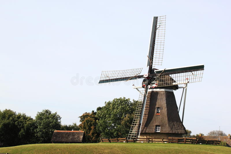 Corn mill De Phenix of Nes, Ameland Island, Holland. Corn mill 'De Phenix' is an old grain and peel mill that still works perfectly, thanks to a thorough royalty free stock images