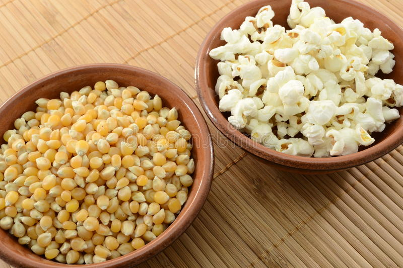 Corn and popcorn. In bowls royalty free stock images