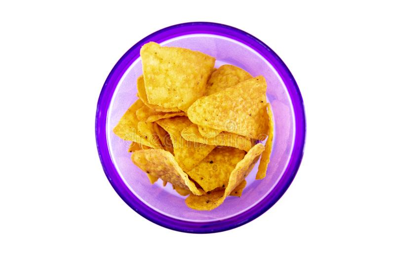 corn snack chips in purple bowl isolated white background stock images