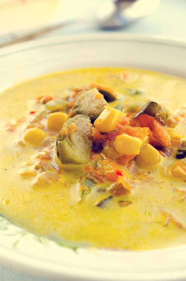 Corn soup with brussels sprouts and other vegetables stock images