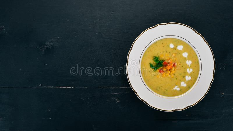 Corn soup with fresh vegetables in a bowl. Healthy food royalty free stock photo