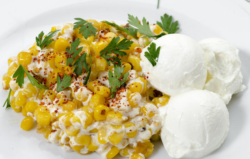 Corn with sour cream. Closeup photography of corn with sour cream royalty free stock images