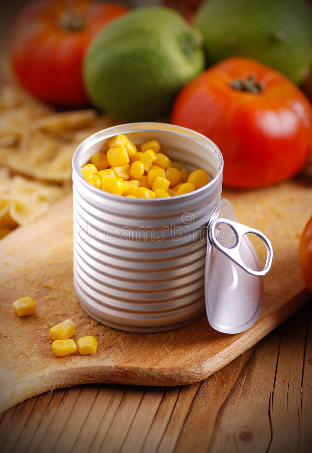 Corn in tin metal. On wood table royalty free stock images