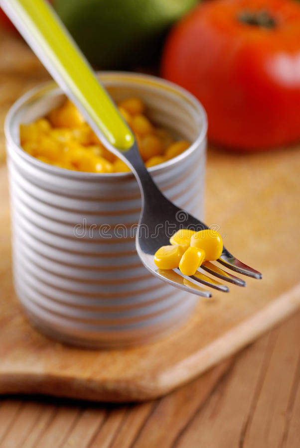 Corn in tin metal. On wood table royalty free stock photography