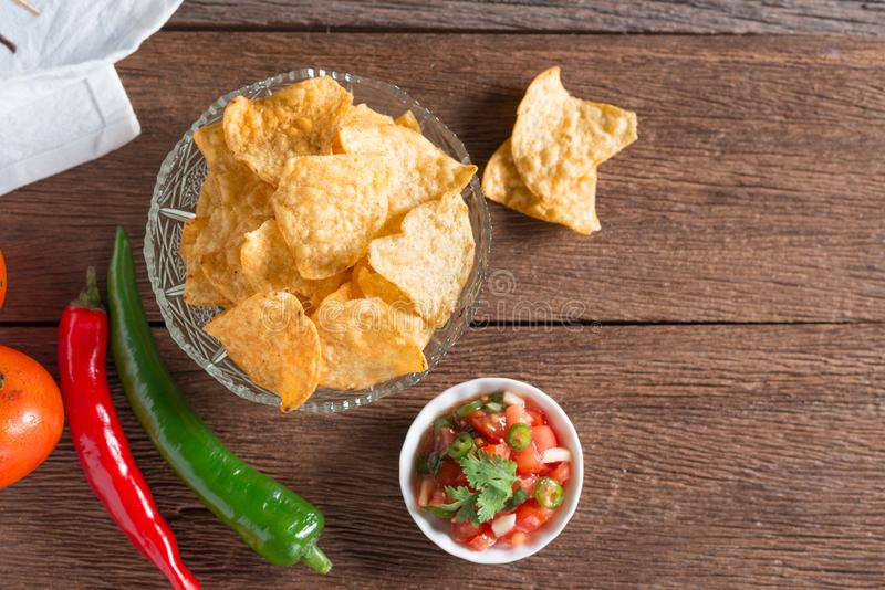 Corn tortilla chips with tomato salsa. Corn tortilla chips with tomato salsa royalty free stock image