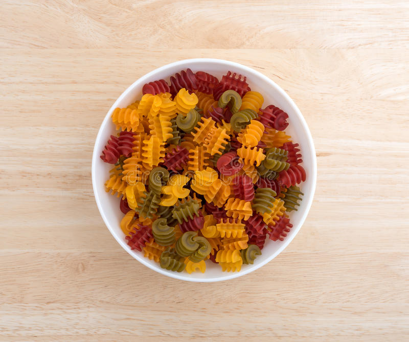 Corn vegetable radiatore pasta in a bowl on wood table royalty free stock photos