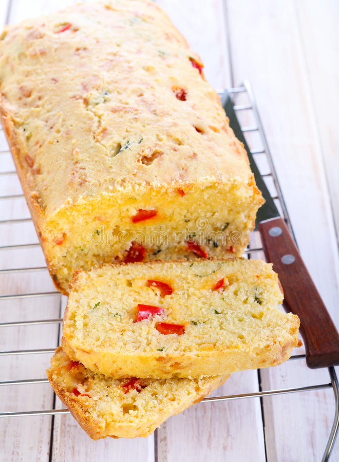 Cornbread. With cheese, red pepper and herbs stock photos