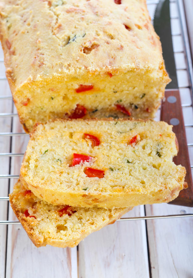 Cornbread. With cheese, red pepper and herbs stock photo