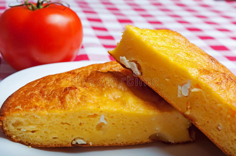 Cornbread with cheese. Two slices of cornbread with cheese close up royalty free stock photo