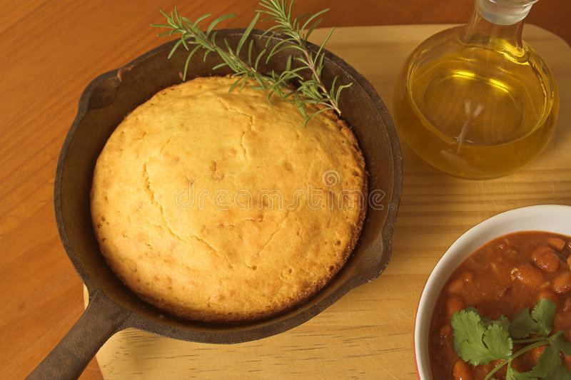 Cornbread and chili. Fresh baked cornbread with a bowl of chili stock photos