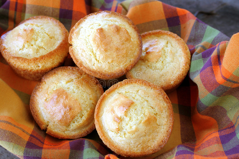 Cornbread Muffins. Close up of a basket full of cornbread muffins stock photos
