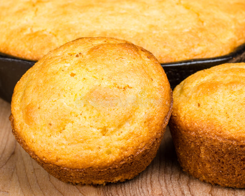 Cornbread muffins and cornbread pone. In an iron skillet stock photos