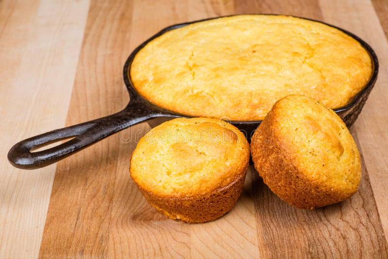 Cornbread muffins and cornbread pone. In an iron skillet stock images