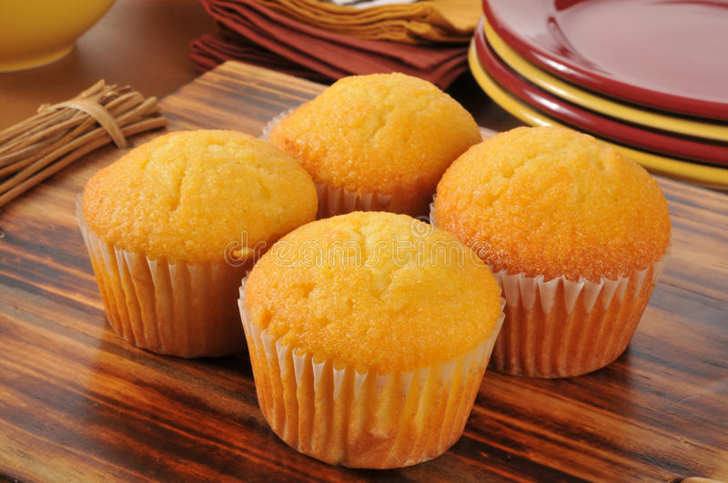 Cornbread muffins. Delicious cornbread muffins on a cutting board stock photography