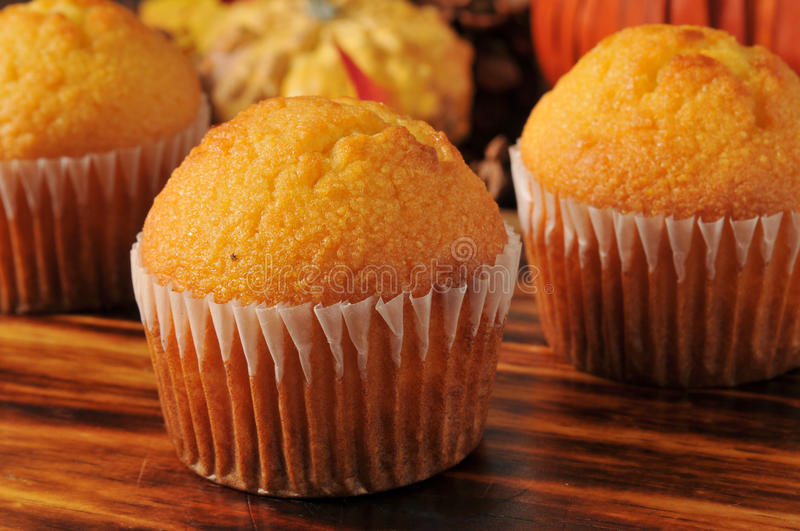 Cornbread muffins. On a holiday table, shallow depth of field, focus on front muffin stock photos
