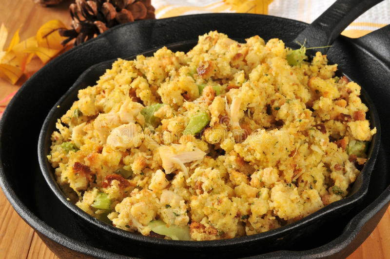 Cornbread stuffing. With chunks of turkey in cast iron skillets royalty free stock images