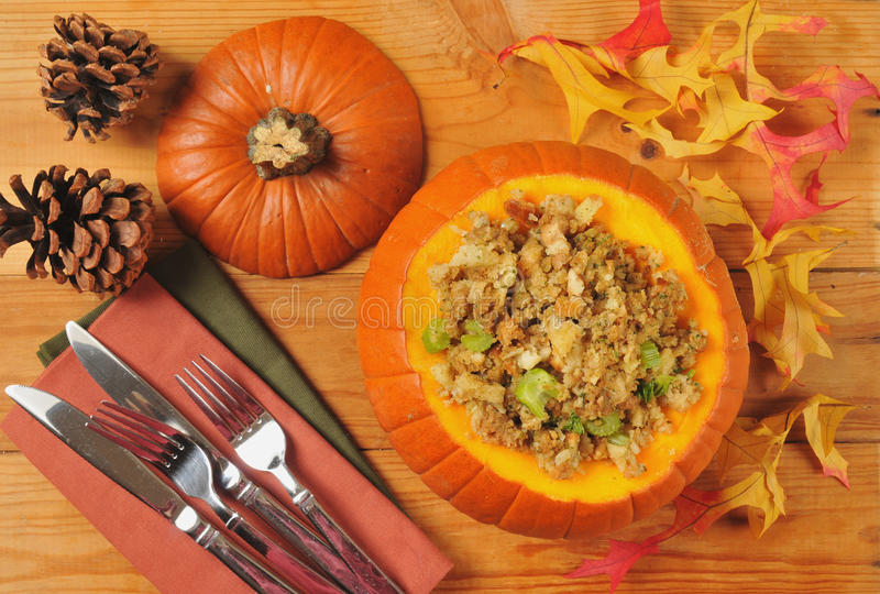 Cornbread stuffing. Cornbread or herbal stuffing in a pumpkin from above stock photos