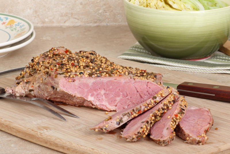 Corned Beef Brisket. Sliced on a cutting board royalty free stock photos