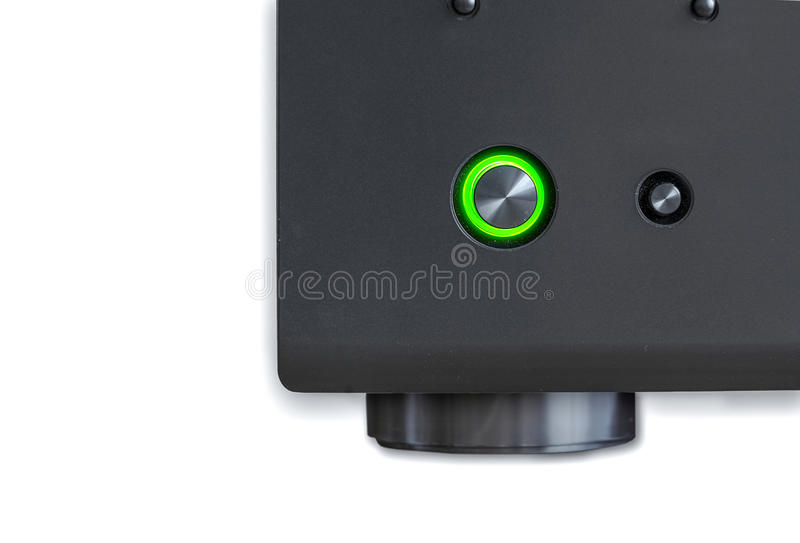 Corner AV receiver with the green power button royalty free stock photos