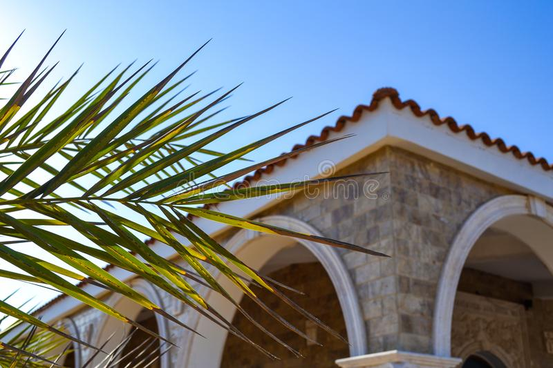 The corner of the building with arches and a tiled roof. royalty free stock photo