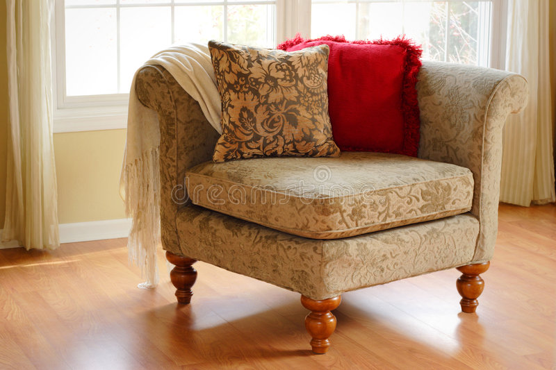 Corner Chair. Decorative corner arm chair in a room by a window royalty free stock photo