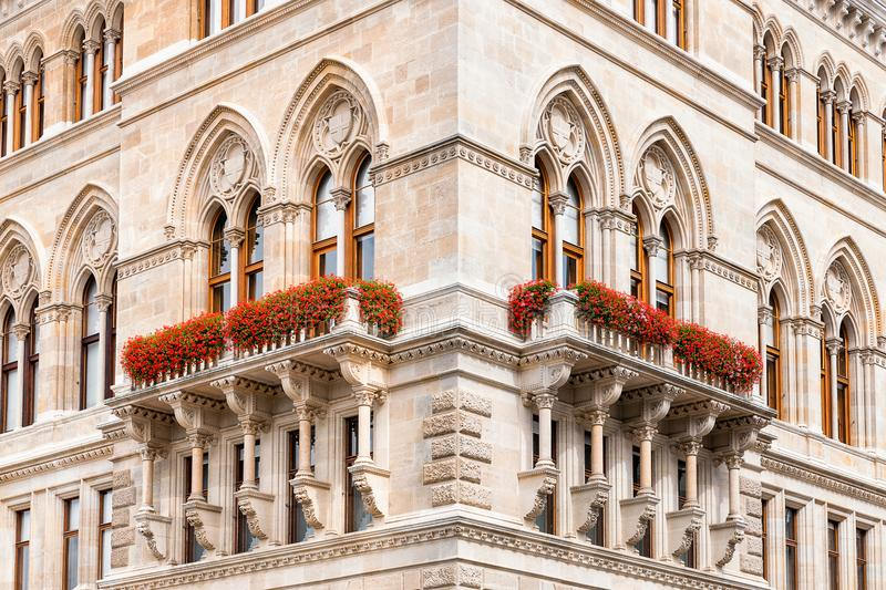 Corner of cityhall historic building in Vienna. Symmetric detail of corner of cityhall historicism building in Vienna, Austria. Neo-gothic windows and arches royalty free stock image