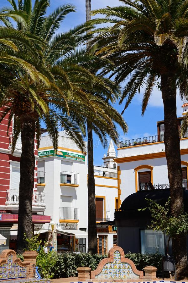 Corner of Coronation Square, Ayamonte. Shops at the corner of Coronation Square Plaza de la Coronacion with palm trees in the foreground, Ayamonte, Huelva royalty free stock photo