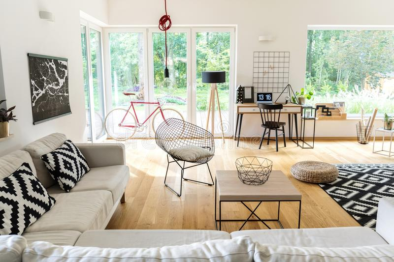 Spacious living room with workspace royalty free stock image