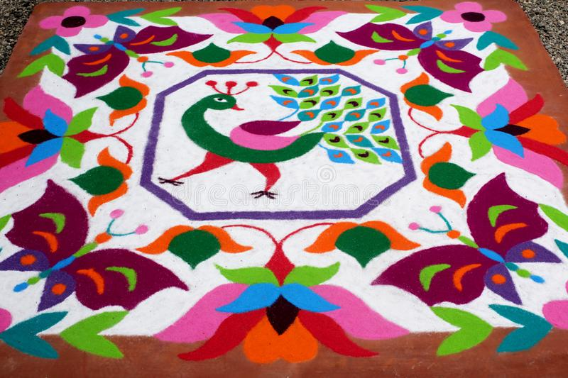 Colourful Rangoli Traditional Floral Design made with Dry Powdered Colours with Peacock, Flowers and Butterflies. A Corner Detail of Colourful Rangoli stock images