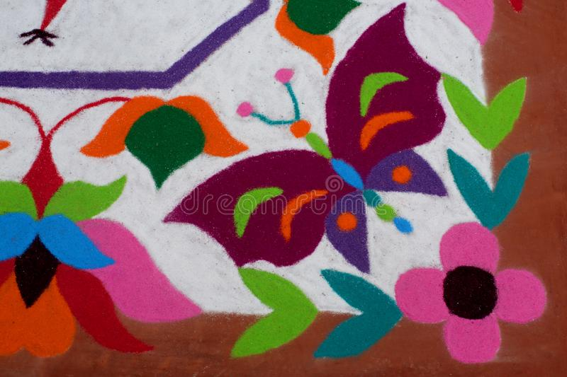 Colourful Rangoli Traditional Floral Design made with Dry Powdered Colours with Peacock, Flowers and Butterflies. A Corner Detail of Colourful Rangoli stock photography