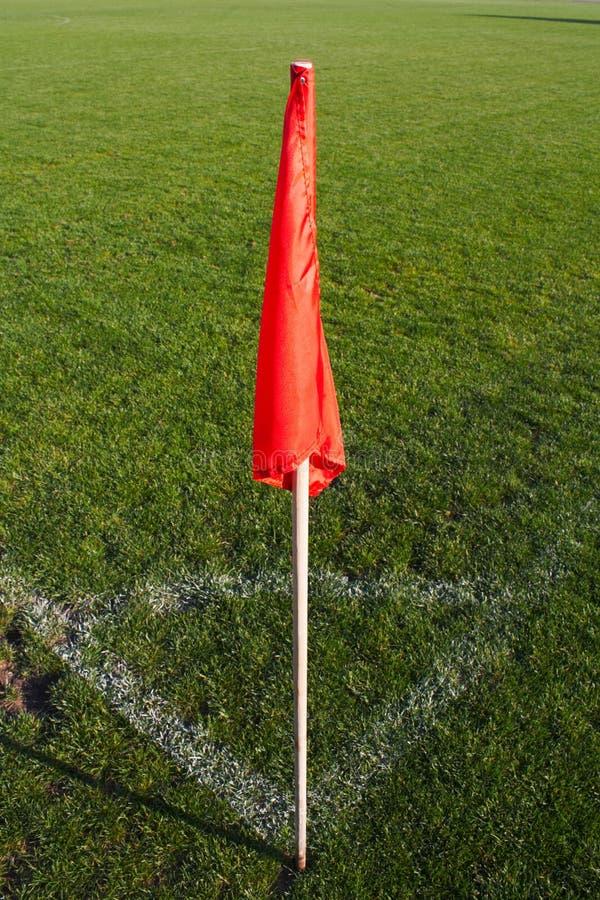 Corner flag on an soccer field. Red corner flag on an soccer field stock photography