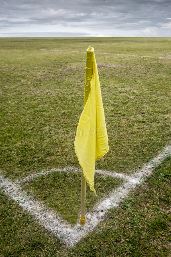 Corner flag. Yellow corner flasg in a soccer field royalty free stock photography