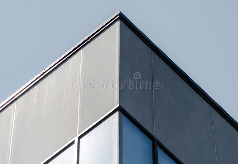 Corner of a gray concrete building with windows. Corner of a concrete building with windows stock photography
