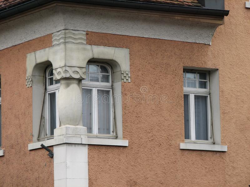 Window with decorated concrete pillar. The corner of the house decorated with stock photography