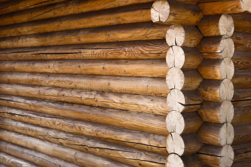 Corner of the house made of wooden logs stock image