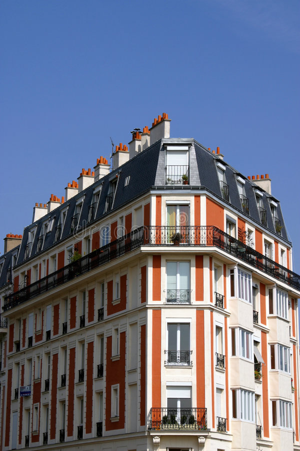 Corner House In Paris. Architecture of traditional corner house located in Paris, France royalty free stock image