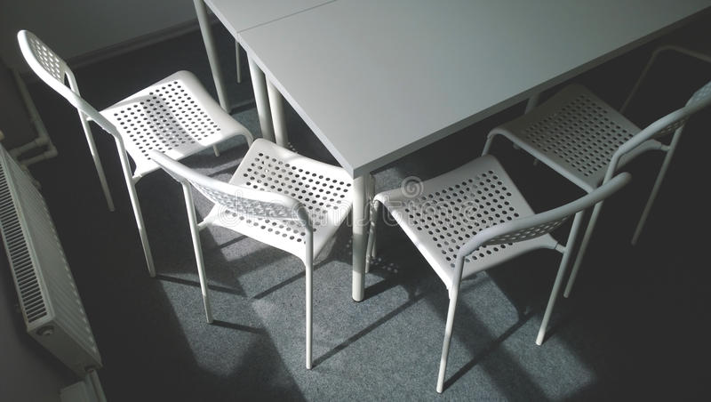 The Corner Of A Large White Conference Table And Four Chairs Next To - Large white conference table