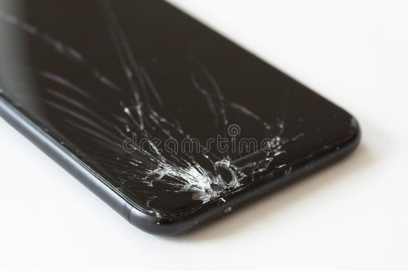 Corner of mobile cell phone with broken display screen after drop. stock image